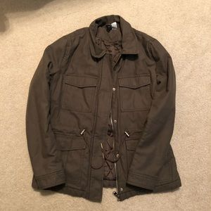 Divided military green utility jacket.